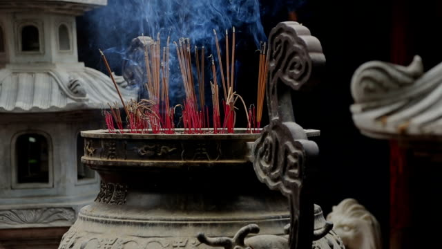 Burning incense In A Temple, Vietnam