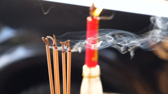 burning joss stick on chinese new year festival day - incense stock videos & royalty-free footage