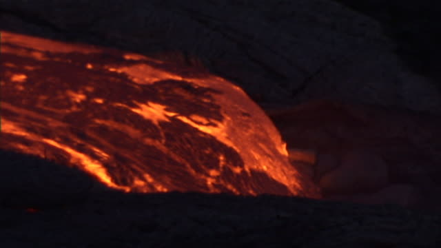 burning lava moves slowly toward the sea. - pacific islands stock videos & royalty-free footage