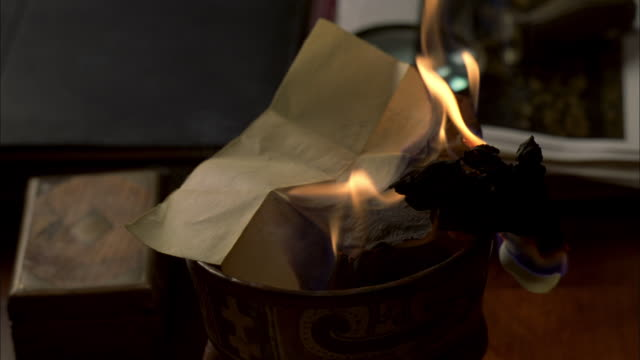 cu burning of document in metal cup - burning stock videos & royalty-free footage