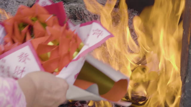 Burning Paper To The Ancestor