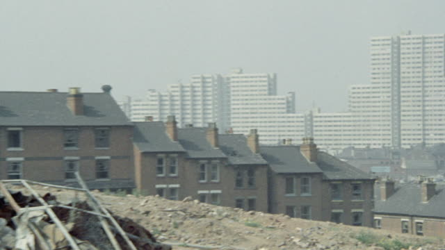 1973 montage burning refuse and dilapidated, old terraced housing to be rebuilt / nottingham, england, united kingdom - 状態点の映像素材/bロール