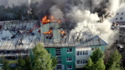 Burning roof of a residential high-rise building, clouds of smoke from the fire. top view