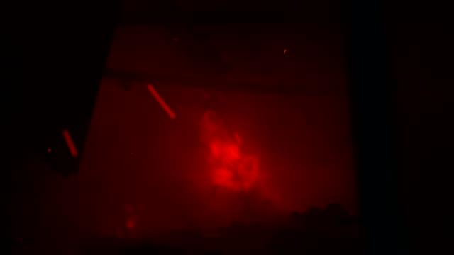 Burning ruined room at night