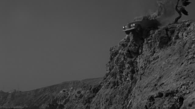 MS Burning sedan teetering on edge of cliff