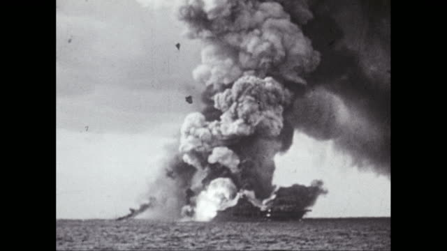 WS Burning smoking, exploding warships at sea / United States