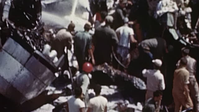 burning, smoking wreckage of crashed b-29 being hosed down with foam by emergency firefighting crew with other usaaf personnel watching during wwii - b29 stock videos & royalty-free footage