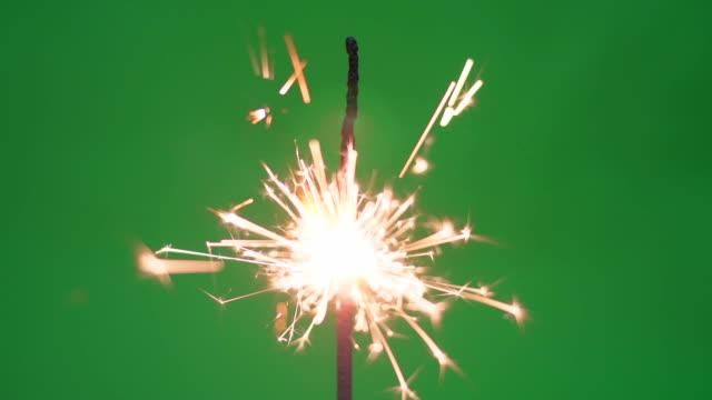 burning sparkler on green screen 4k - sparkler stock videos & royalty-free footage