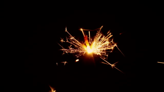 burning sparkler - firework explosive material stock videos and b-roll footage