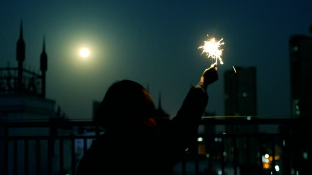 burning sparklers at night - 後ろボケ点の映像素材/bロール