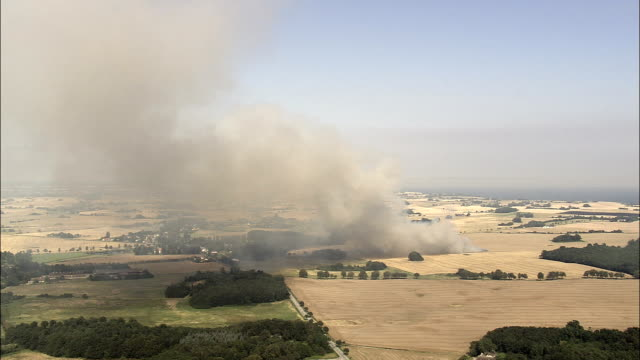 burning stubble near damsholte  - aerial view - zealand, vordingborg kommune, denmark - stubble stock videos & royalty-free footage
