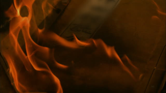 burning the books in china - motion graphics stock videos & royalty-free footage