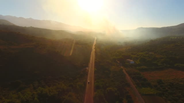 burning trees. crete, greece. road in the mountains. aerial drone shot. - mountain road stock videos & royalty-free footage