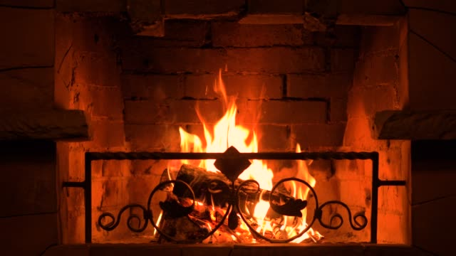 burning wood in the fireplace. - brick stock videos & royalty-free footage