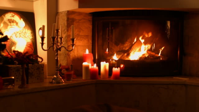 burning wood in the fireplace. - candle stock videos and b-roll footage