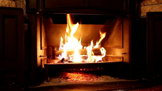 burning wood in the fireplace - stone object stock videos and b-roll footage