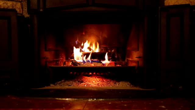 burning wood in the fireplace - stone material stock videos & royalty-free footage
