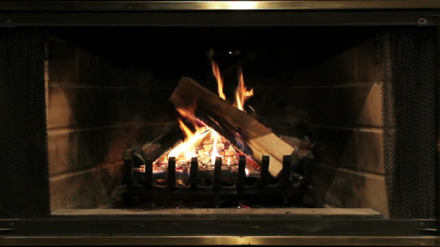 burning wood inside fireplace - fireplace stock videos and b-roll footage
