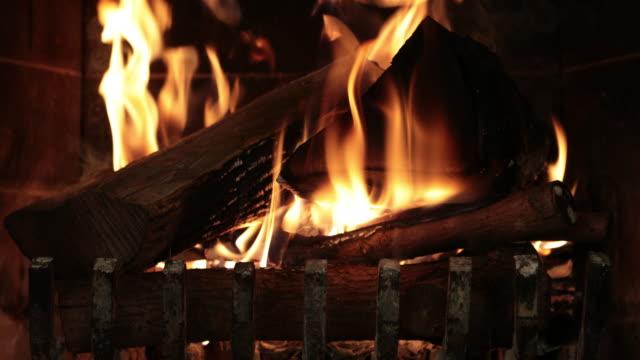 Burning Wood Inside Fireplace