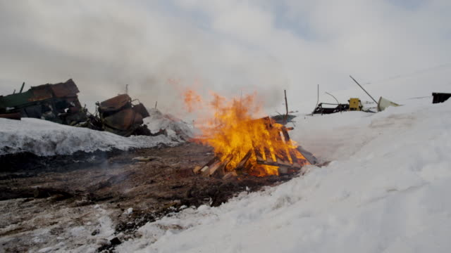 burning wood on a garbage dump in barentsburg, spitsbergen, svalbard - ussr stock videos and b-roll footage