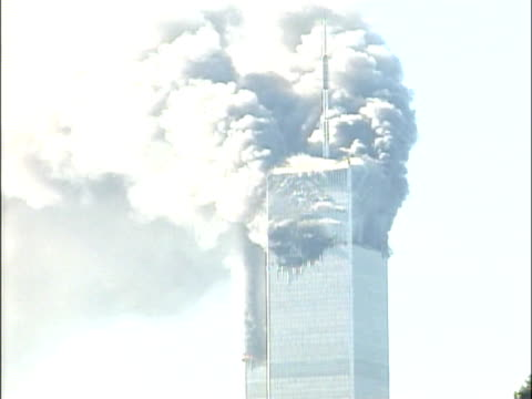 stockvideo's en b-roll-footage met burning world trade center building smoke pouring from towers attack on the world trade center on september 11 2001 in new york new york - aanslagen op 11 september 2001