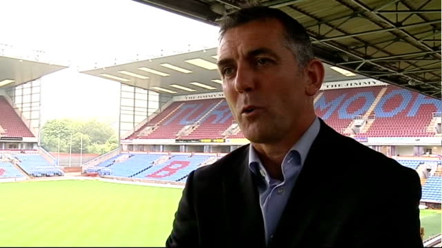 burnley prepare for first season in premier league; england: lancashire: burnley: turf moor: ext coyle interview sot - need to concentrate on first... - turf stock videos & royalty-free footage