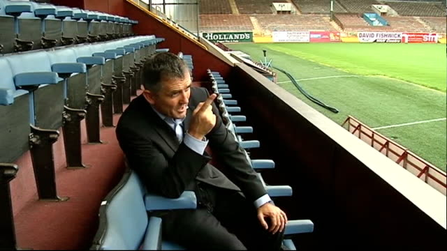 burnley prepare for first season in premier league; england: lancashire: burnley: turf moor: ext shots of owen coyle in stands coyle talking to press... - turf stock videos & royalty-free footage