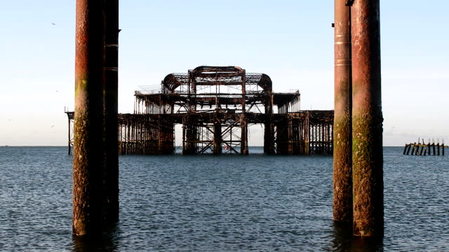 burnt brighton west pier at sunrise - imperfection stock videos & royalty-free footage