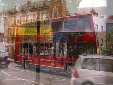 vídeos de stock e filmes b-roll de burnt bus and damaged shops in peckham following period of riots in london neighbourhoods august 2011 - peckham