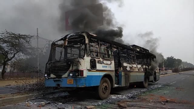burnt bus is among the damage inflicted by demonstrators upset with the release of padmaavat a bollywood epic about a mythical hindu queen - epic film stock videos & royalty-free footage