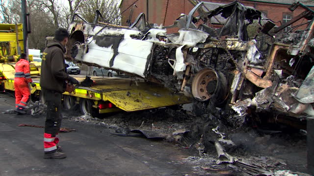 burnt out bus removed from street in belfast, after it was fire bombed by rioters, as tensions rise between loyalists and nationalists - burnt stock videos & royalty-free footage