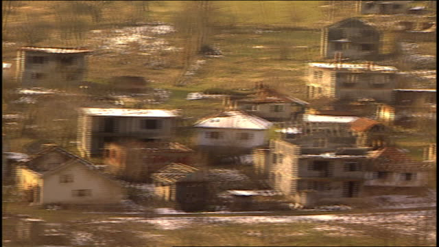 burnt out homes and damaged in bosnia as seen from helicopter - bosnian war stock videos & royalty-free footage