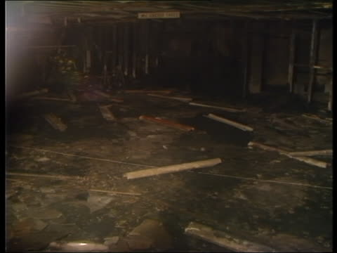burnt out interior of kings cross station following large fire 1987 - キングスクロス駅点の映像素材/bロール