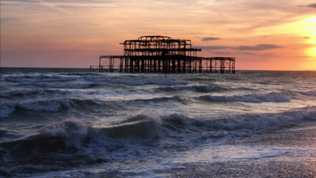 burnt out ruins of west pier, brighton at sunset - 1975 stock videos and b-roll footage