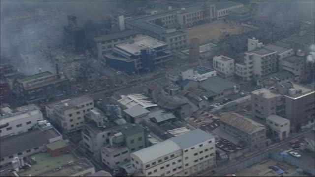 Burntout side of Takatori District of Kobe City Fire is still smoldering Wide shot Zoom in Streets where fire is still spreading Aerial shot