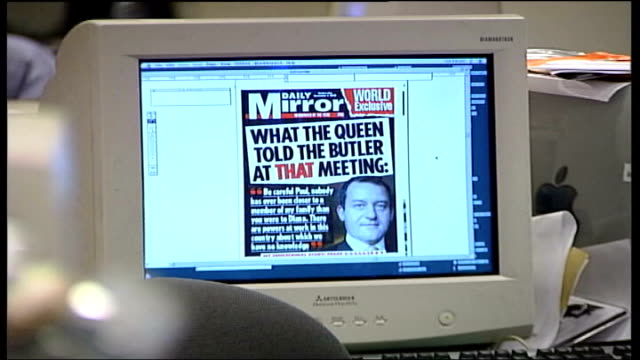 stockvideo's en b-roll-footage met prince of wales household inquiry lib int 'daily mirror' front page displayed on computer pan journalist working at computer - daily mirror