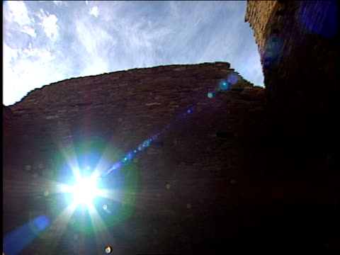 a burst of sunlight radiates through a window opening in pueblo bonito ruins. - chaco canyon stock videos & royalty-free footage