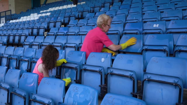 bury fc fans and hundreds of volunteers clean their stadium as they await a decision on the future of the club. - anticipation stock videos & royalty-free footage