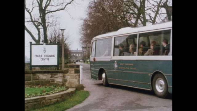 bus arrives at police training centre - military recruit stock videos & royalty-free footage