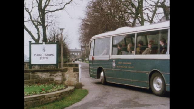 bus arrives at police training centre - rekrut stock-videos und b-roll-filmmaterial