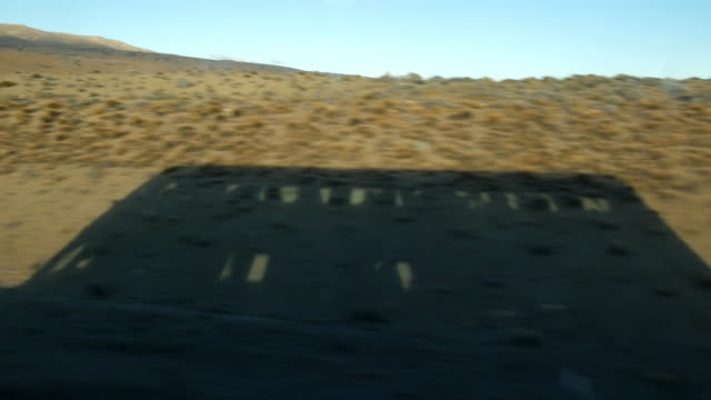 A bus coach shadow while crossing the Argentinian Patagonia