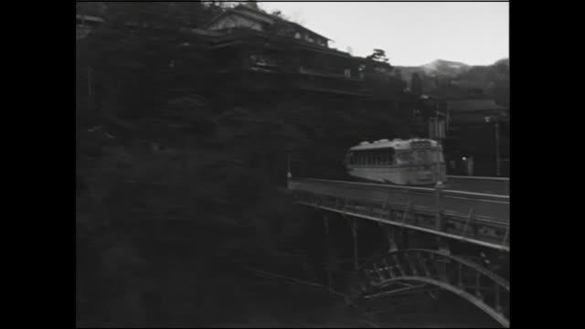 A bus crosses a bridge near a hot springs resort in Hakone, Kanagawa.