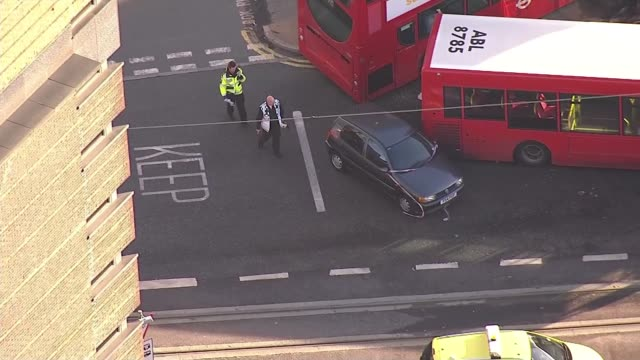 bus driver arrested on suspicion of drink driving after crashing into bus shelter; england: london: croydon: ext air view double decker bus crashed... - ロンドン クロイドン点の映像素材/bロール