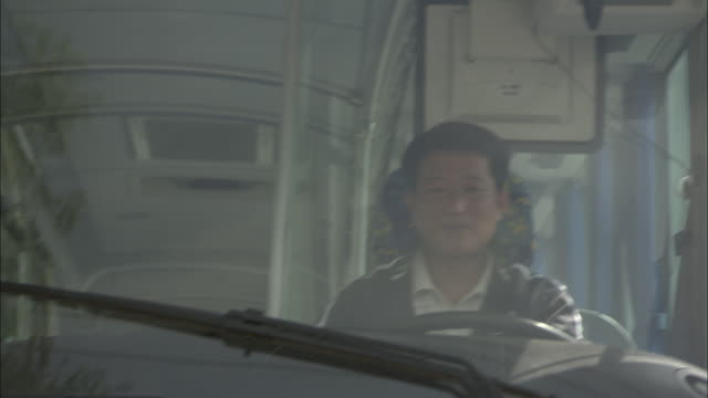 cu rear pov bus driver driving fuel cell bus, beijing, beijing, china - bus driver stock videos & royalty-free footage