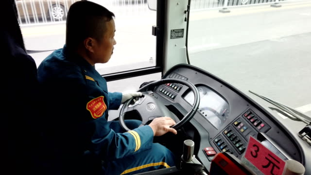 bus driver driving/tianjin,china. - bus driver stock videos & royalty-free footage