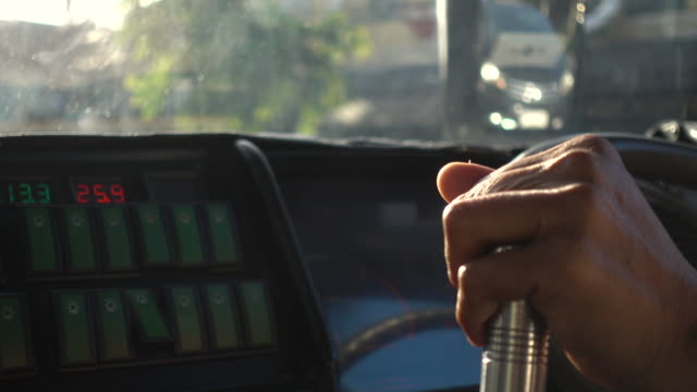 bus driver hands on steering wheel close up - bus driver stock videos & royalty-free footage