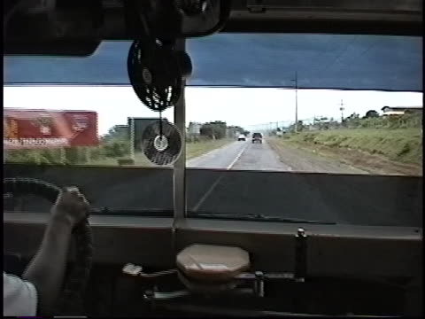A bus driver navigates a highway outside Managua Nicaragua in 1999 Nicaragua is one of the poorest countries in the Western Hemisphere