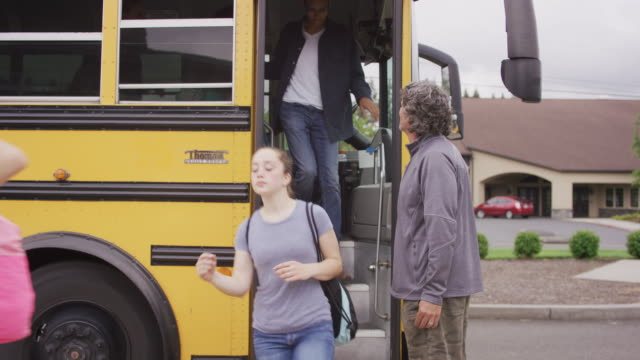 bus driver ushering students off of school bus - bus driver stock videos & royalty-free footage