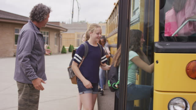 bus driver ushering students onto bus - back to school stock videos and b-roll footage