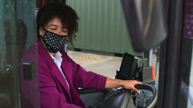 bus driver wearing a protective mask - mid adult women stock videos & royalty-free footage